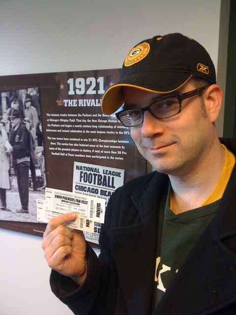 <div class='photo-info'><span class='counter'>22 of 22</span>Posted Jul 28, 2010</div><div class='photo-title'>Got the goods</div><div class='photo-body'>Aaron holds up our 2 tickets to Fan Fest</div>