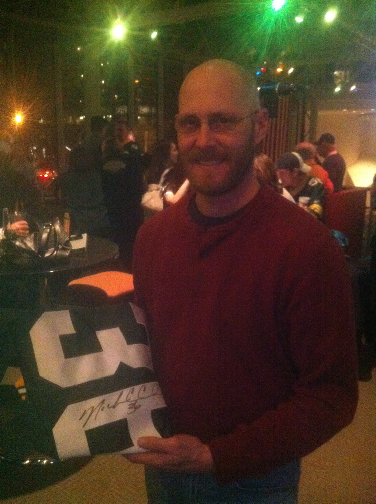 <div class='photo-info'><span class='counter'>39 of 49</span>Posted Jan 25, 2011</div><div class='photo-title'>@WallyPingel wins Nick Collins Jersey at Packer Pep Rally</div><div class='photo-body'>oh yeah - BONUS!</div>