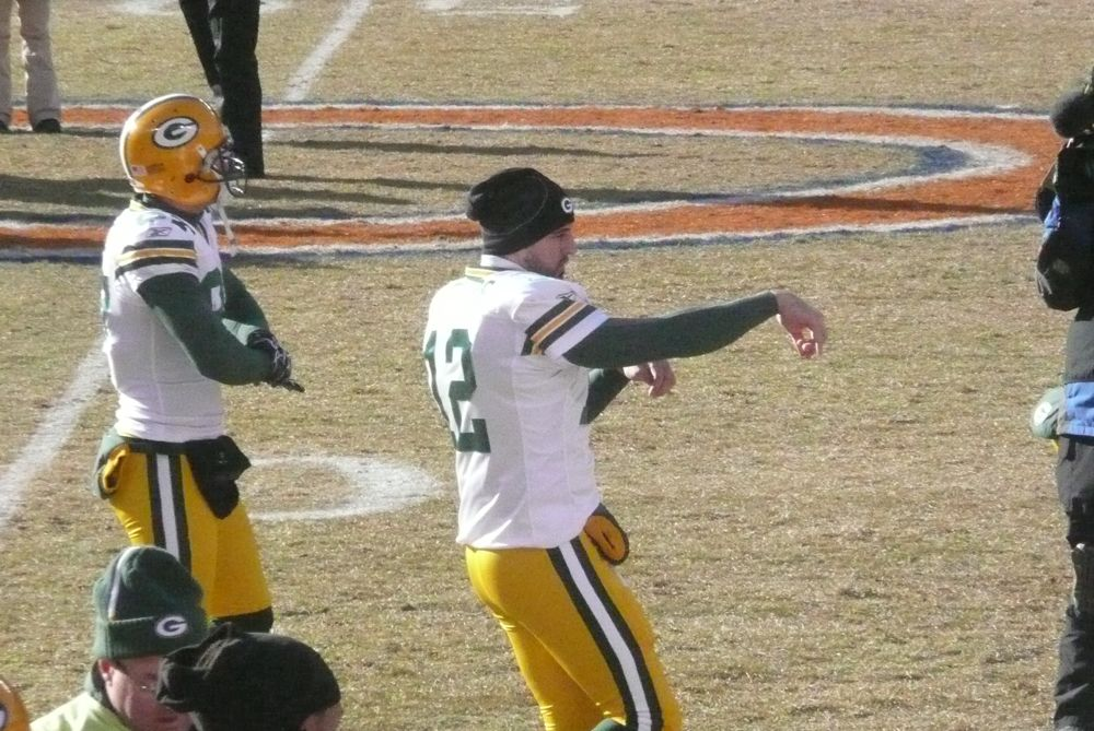 <div class='photo-info'><span class='counter'>8 of 49</span>Posted Jan 25, 2011</div><div class='photo-title'>Rodgers Pre-game Warm-Up</div><div class='photo-body'>Photos Taken by @Mat_Trix</div>