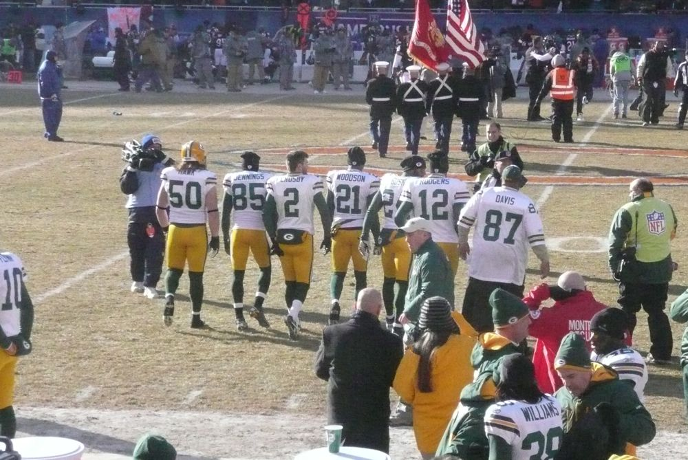 <div class='photo-info'><span class='counter'>14 of 49</span>Posted Jan 25, 2011</div><div class='photo-title'>Packer Captains to the Coin Toss</div><div class='photo-body'>Photos Taken by @Mat_Trix</div>