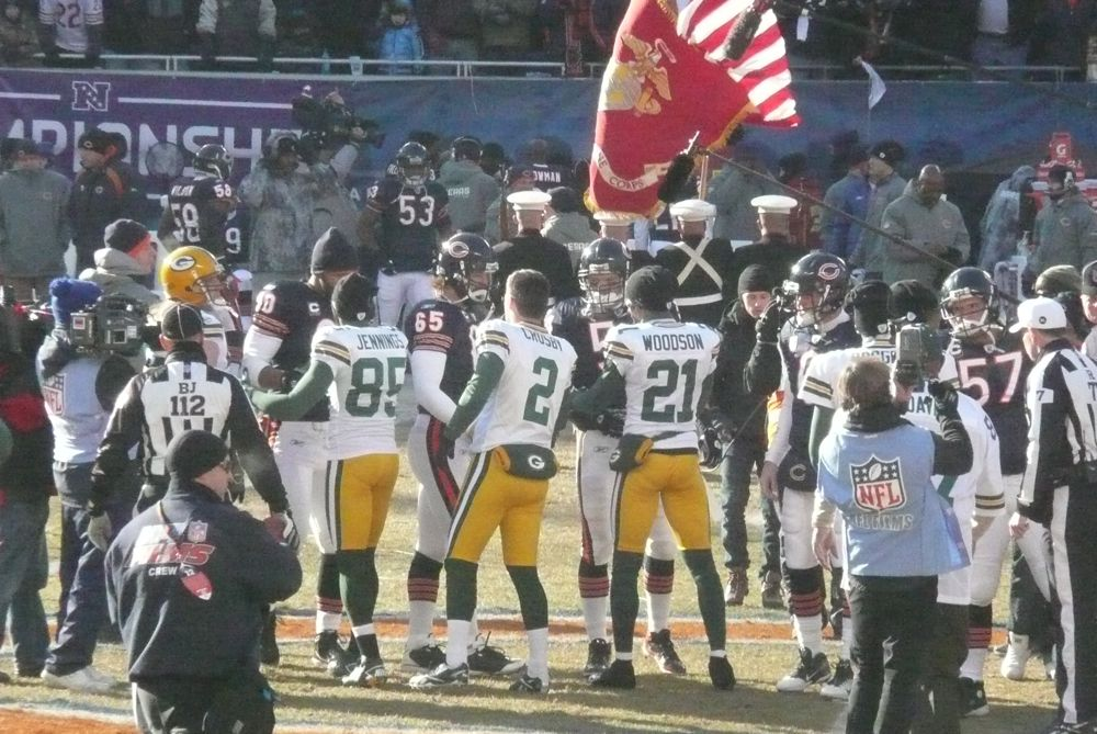 <div class='photo-info'><span class='counter'>14 of 49</span>Posted Jan 25, 2011</div><div class='photo-title'>Packers and Bears Coin Toss</div><div class='photo-body'>Photos Taken by @Mat_Trix</div>