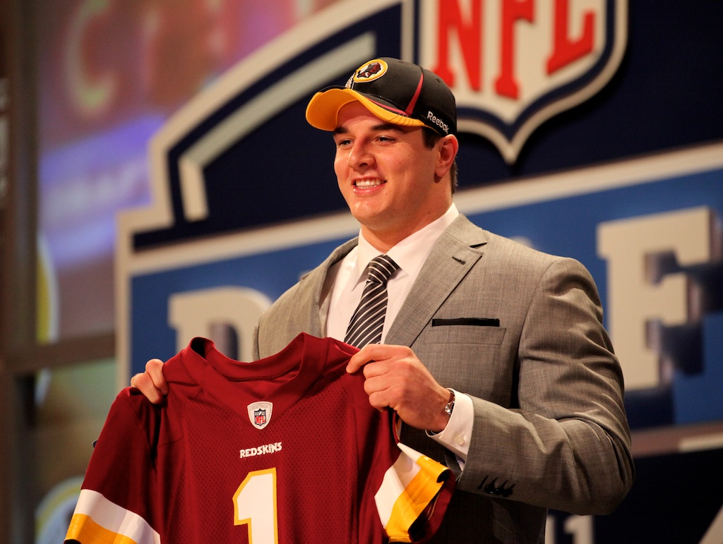 <div class='photo-info'><span class='counter'>38 of 50</span>Posted Apr 29, 2011</div><div class='photo-title'>Ryan Kerrigan</div><div class='photo-body'>Ryan Kerrigan with Commissioner Roger Goodell after being selected by the Washington Redskins during the 2011 NFL Draft at Radio City Music Hall on April 28, 2011 in New York, NY.</div>
