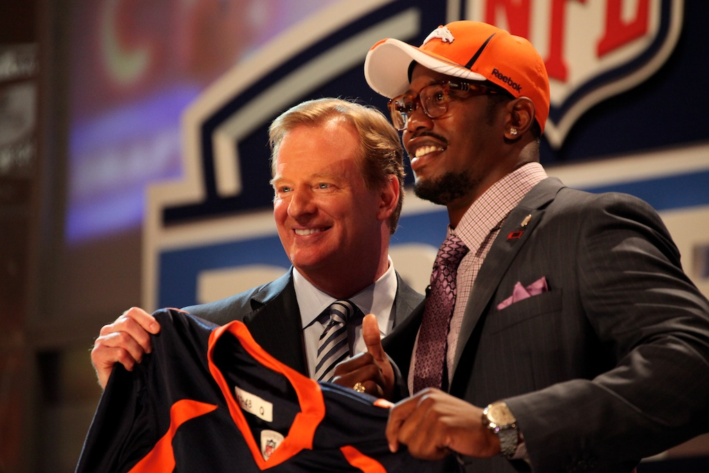 <div class='photo-info'><span class='counter'>29 of 50</span>Posted Apr 29, 2011</div><div class='photo-title'>Von Miller &amp; Roger Goodell</div><div class='photo-body'>Von Miller poses with Roger Goodell after being selected by the Denver Broncos during the 2011 NFL Draft at Radio City Music Hall on April 28, 2011 in New York, NY.</div>