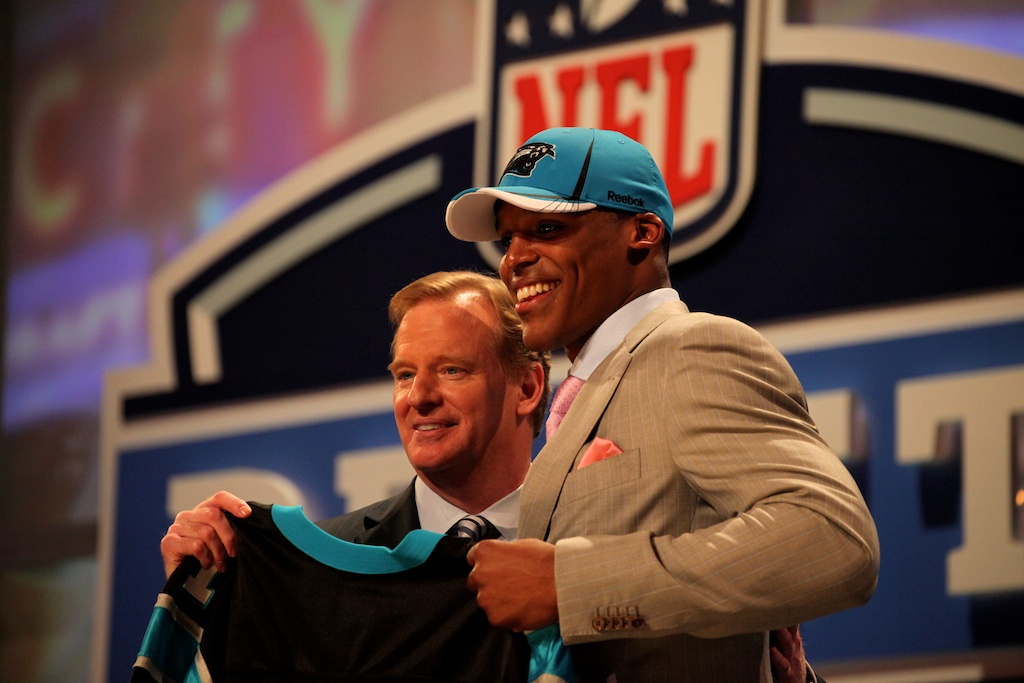 <div class='photo-info'><span class='counter'>27 of 50</span>Posted Apr 29, 2011</div><div class='photo-title'>Cam Newton &amp; Roger Goodell</div><div class='photo-body'>Quarterback Cam Newton poses with the NFL commissioner, Roger Goodell, after being selected as the first overall pick by the Carolina Panthers.</div>