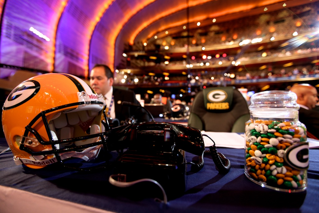 <div class='photo-info'><span class='counter'>9 of 50</span>Posted Apr 29, 2011</div><div class='photo-title'>Packer Helmet, Phone and Candy</div><div class='photo-body'>2011 NFL Draft at Radio City Music Hall on April 28, 2011 in New York, NY</div>