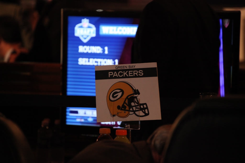 <div class='photo-info'><span class='counter'>4 of 50</span>Posted Apr 29, 2011</div><div class='photo-title'>Packer Draft Flag</div><div class='photo-body'>Packer Card at the Team Draft Table the 2011 NFL Draft at Radio City Music Hall on April 29, 2011 in New York, NY.</div>