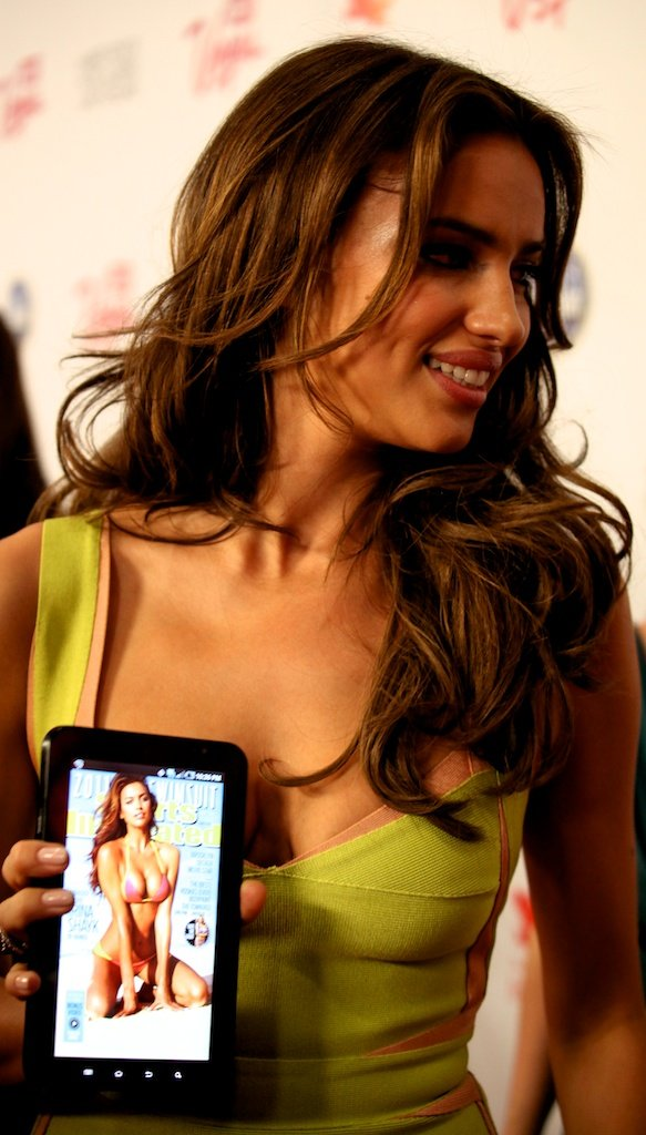 <div class='photo-info'><span class='counter'>2 of 35</span>Posted Mar 28, 2011</div><div class='photo-title'>Irina Shayk with Tablet App SI Cover</div><div class='photo-body'>SI Swimsuit Cover Model Irina Shayk holds up the swimsuit issue on an Android tablet for the Red Carpet in Vegas at the Hard Rock Cafe for the Sports Illustrated Swimsuit Launch 2011</div>