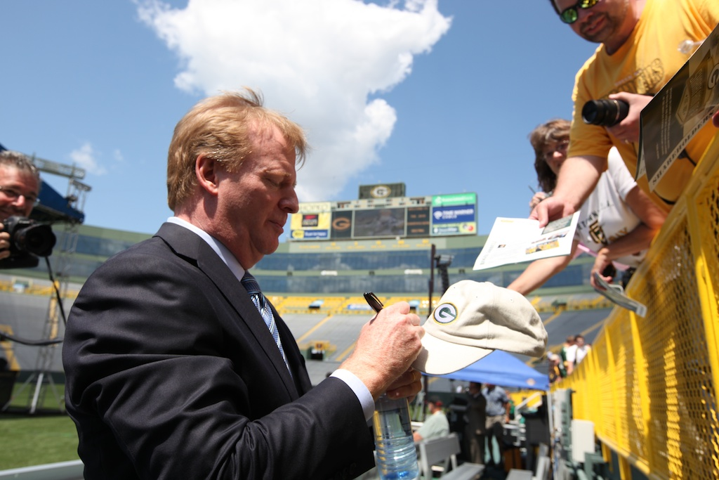 Roger Goodell signs autographs for Fans