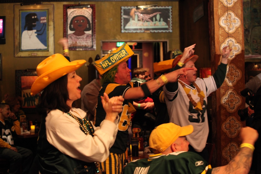 <div class='photo-info'><span class='counter'>6 of 13</span>Posted Feb 03, 2011</div><div class='photo-title'>Packer Fans Cheer on the Show</div><div class='photo-body'>Packer Fans Rally at the House of Blues in Dallas on Wed Night Feb 2nd. A taping of Inside the Huddle took place with guests, Santana Dotson and James Jones.</div>