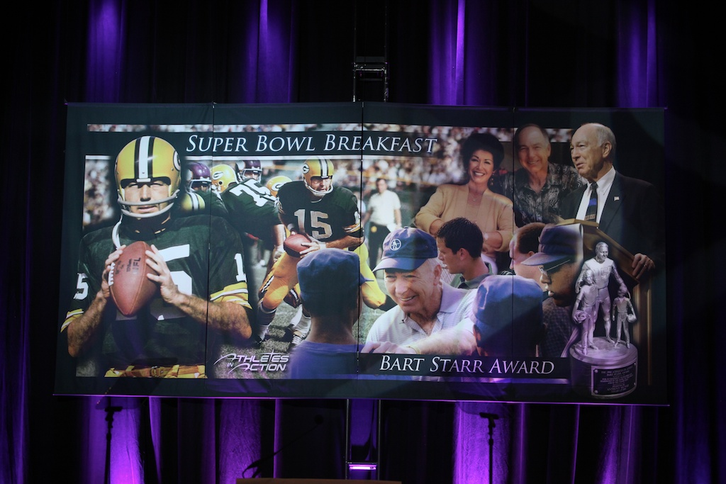 <div class='photo-info'><span class='counter'>18 of 21</span>Posted Feb 11, 2011</div><div class='photo-title'>Super Bowl Breakfast Banner</div><div class='photo-body'>Bart Starr Award at Super Bowl Breakfast 2011: Feb. 5, 2011</div>