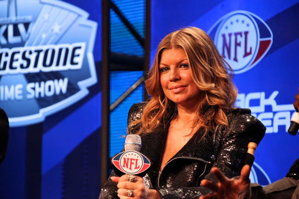 <div class='photo-info'><span class='counter'>35 of 73</span>Posted Feb 04, 2011</div><div class='photo-title'>Fergie of the Black Eyed Peas</div><div class='photo-body'>NFL Super Bowl Media Center pics from Friday Feb 4th 2011</div>