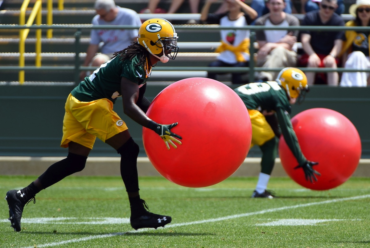 Green Bay Packers cornerback Davon House takes part in an offseason practice, by Benny Sieu—USA TODAY Sports.