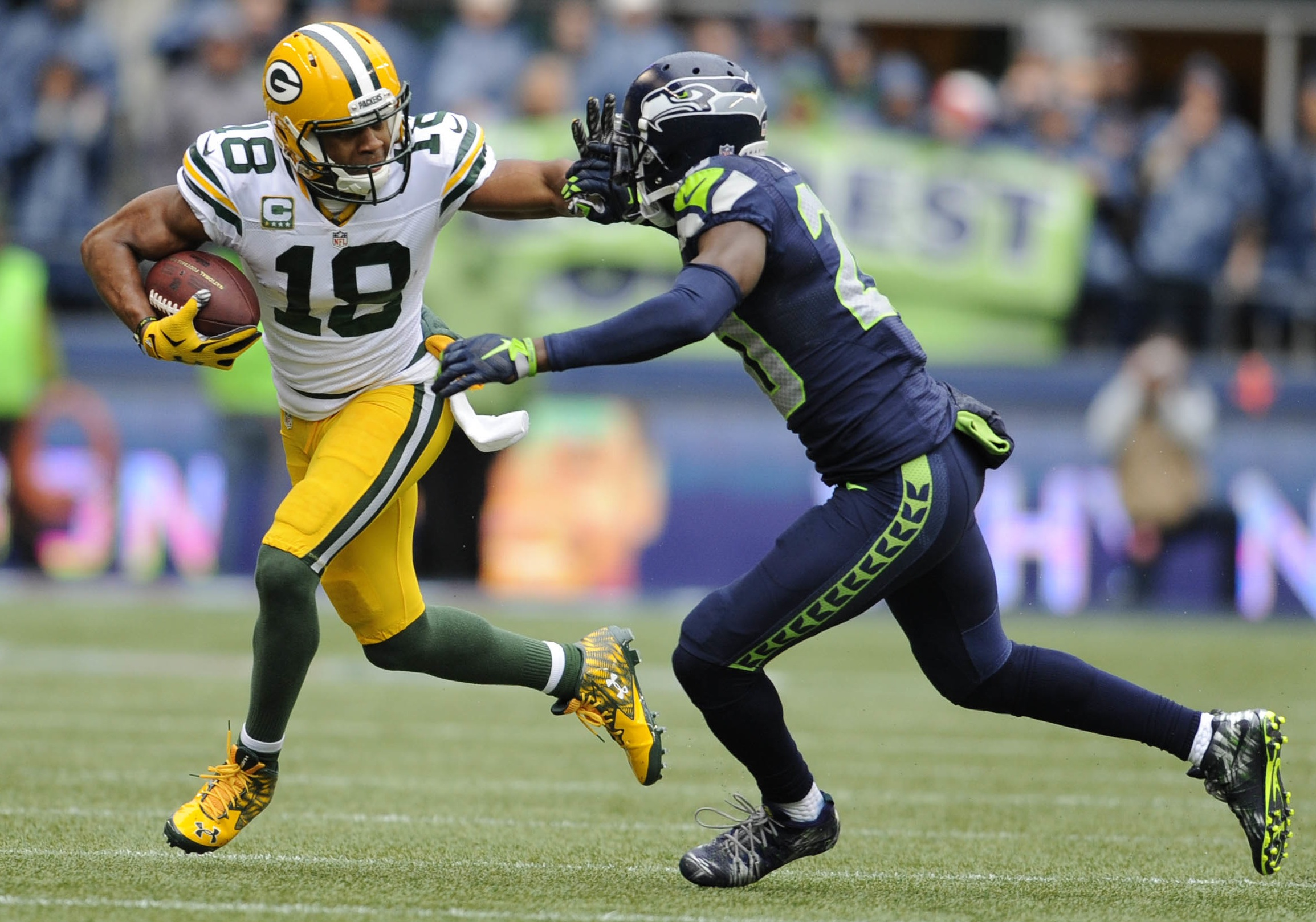 Green Bay Packers wide receiver Randall Cobb and Seattle Seahawks cornerback Jeremy Lane—Steven Bisig, USA TODAY Sports.