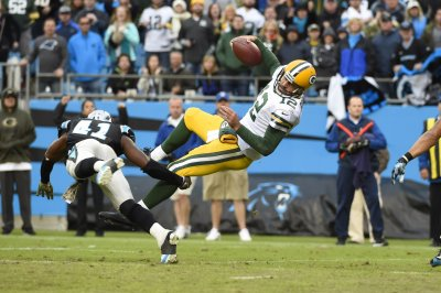 Packers vs. Panthers: Game Balls & Lame Calls