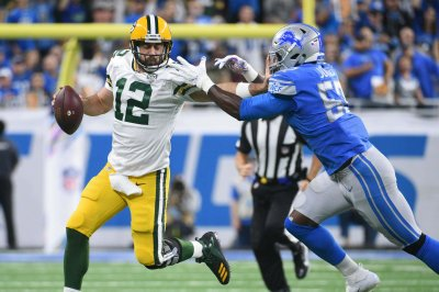 Packers Struggle, Fall to Lions 31-23