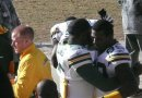 Nick Collins hugs James Jones